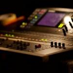 Soundboard mixer at a concert, shallow focus...