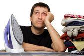 Sad man, ironing board, wash clothing and iron