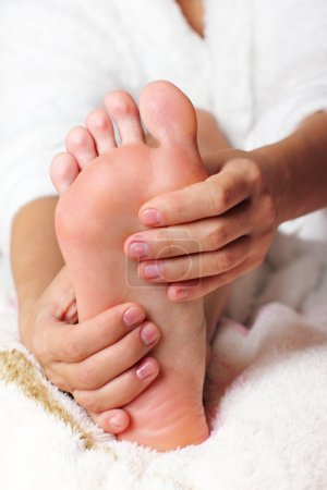 Photo for Young woman massaging his feet - Royalty Free Image