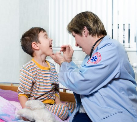 Doctor of ambulance and sick child