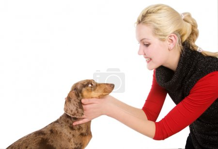 Beautiful blonde girl with badger-dog