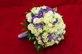 A bouquet isolated on red background