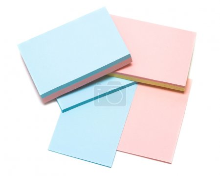 Colored pages of notebook on white