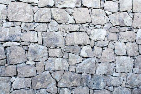 Photo pour Contexte de texture de mur de pierre - image libre de droit