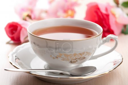 Photo for Cup of tea and roses - Royalty Free Image