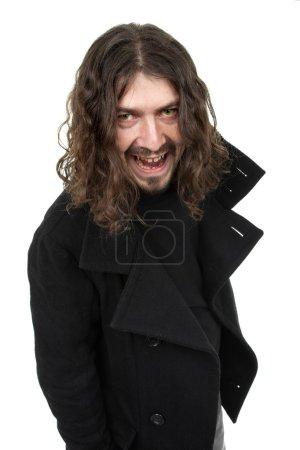 Photo pour Jeune homme habillé comme un vampire, isolé sur blanc - image libre de droit