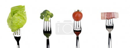 Photo for Broccoli, tomato, lettuce salad and slice of bacon on forks isolated on a white background. - Royalty Free Image