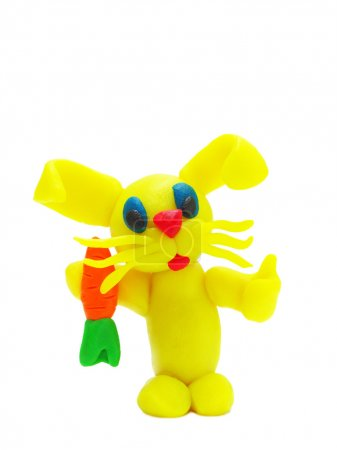Yellow plasticine rabbit with carrot