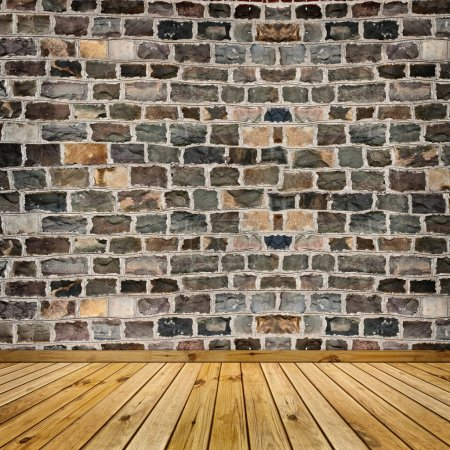 Photo for Coarse stone wall and the wooden floor - Royalty Free Image