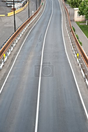 Photo for Asphalt road. A transport highway with white marking. - Royalty Free Image