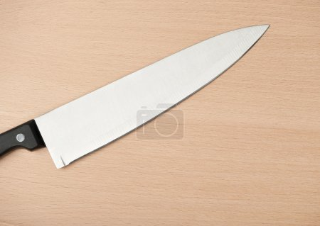 Photo for Knife and board for cutting food. Studio shooting. - Royalty Free Image