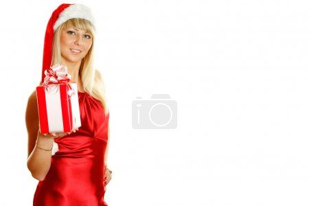 Photo for Beautiful girl in a red dress and hat of Santa with a big gift box. Lots of copyspace and room for text on this isolate - Royalty Free Image