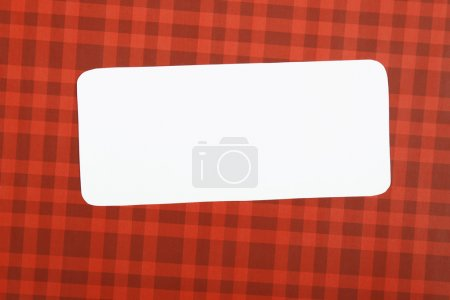 Photo for Greeting Christmas card with a red background white sheet of paper on which you can write a text - Royalty Free Image