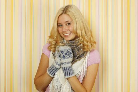 Photo for Photos of beautiful young Russian woman in mild winter mittens and a scarf. Happy - Royalty Free Image