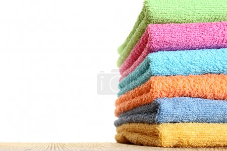 Photo for Lots of colorful bath towels stacked on each other. Isolated - Royalty Free Image