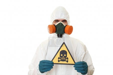 Photo for Man in protective suit, a mask and a respirator. Holds a sign with a skull. Isolated on white - Royalty Free Image