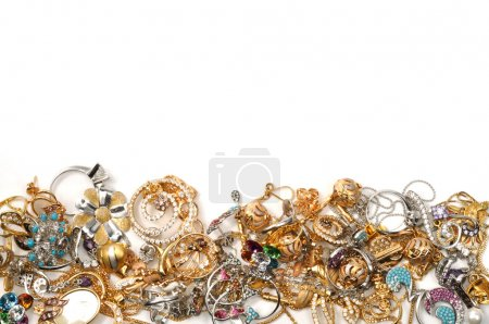Photo for Border of yellow and white gold jewelry, on the white - Royalty Free Image