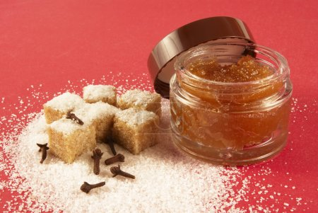 Body scrub with brown sugar crystals, spicinesses,...