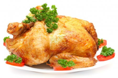 Baked Holiday Turkey with garnish isolated over white