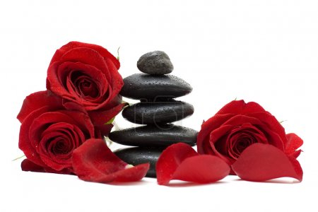 Flowers and spa black stones isolated on white