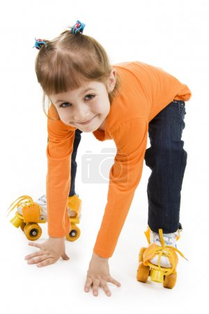 Photo for The little girl on roller skates - Royalty Free Image