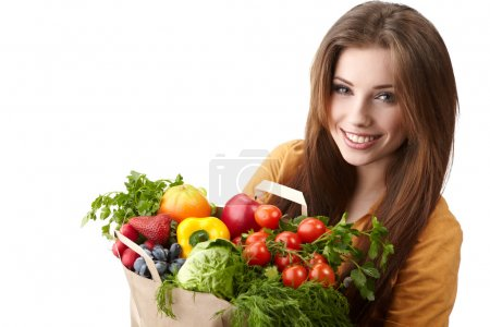 Photo pour Femme tenant un sac plein d'aliments sains. Shopping . - image libre de droit