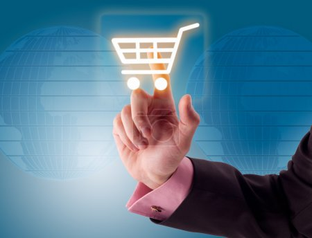Photo for Man hand pressing shopping cart icon - Royalty Free Image