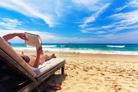 Photo for Relaxing on the beach Relaxing And Reading On The Beach - Royalty Free Image