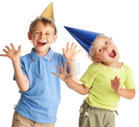 Photo pour Joyeux enfant dans un chapeau de fête - image libre de droit