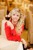 Young woman with red wine