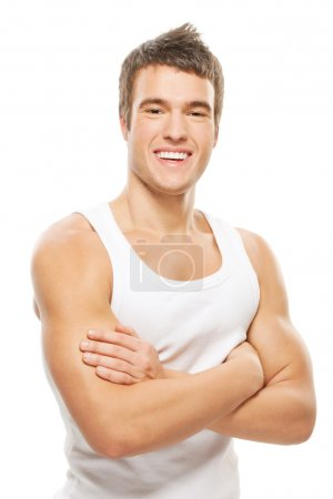 Photo for Portrait of muscular athlete man closing hands on chest on white - Royalty Free Image