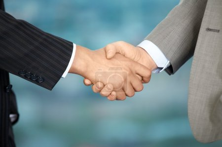 Photo for Two business men shake each other hands at office - Royalty Free Image