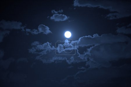Photo for Night landscape of the cloudy sky and the moon - Royalty Free Image