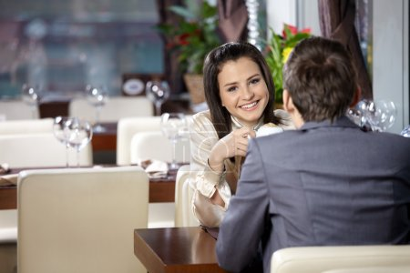 Photo for Two happy enamoured sit at restaurant - Royalty Free Image