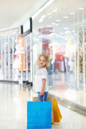 Photo for Little girl with bags in the store - Royalty Free Image
