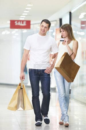 Photo for An attractive couple with a credit card at the store - Royalty Free Image