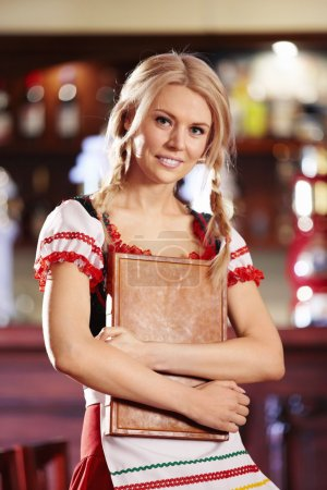 Photo for A pretty young waitress holding menu in his hand - Royalty Free Image