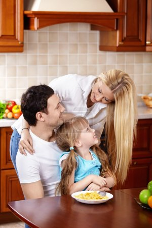 Photo for Happy family with the child in kitchen during a breakfast - Royalty Free Image