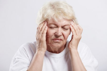 Photo for An elderly woman suffering headache - Royalty Free Image