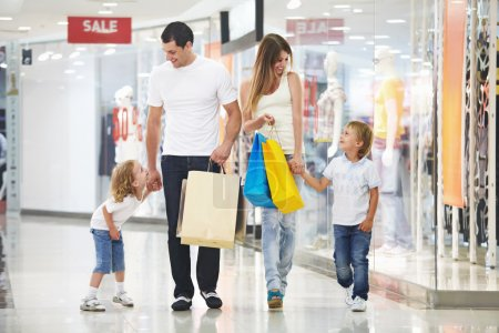 Photo for Young family with two children in the store - Royalty Free Image