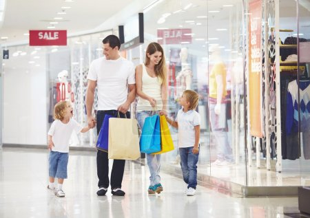 Photo for A happy family makes purchases in the store - Royalty Free Image