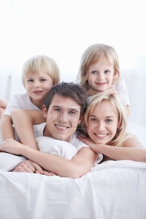 Photo for A happy family with two children in the bedroom - Royalty Free Image