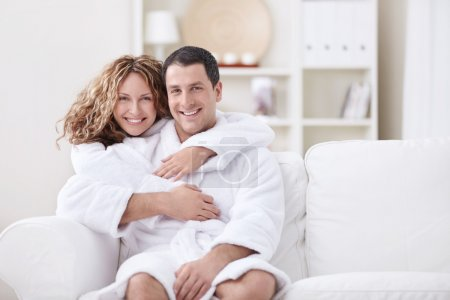 Embracing couple at home