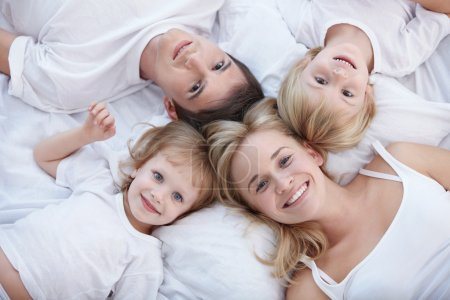Photo for Young families with children on the bed - Royalty Free Image