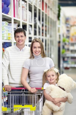 Photo for Families with a child makes a purchase in a store - Royalty Free Image