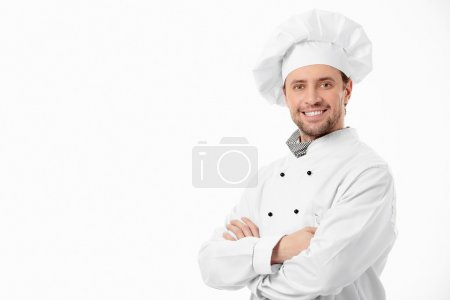 Photo for Attractive smiling chef on a white background - Royalty Free Image