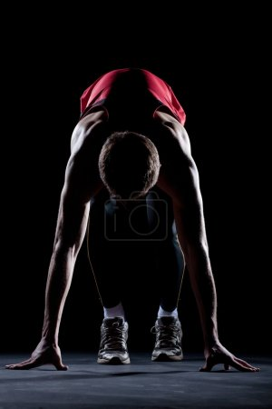 Photo for Male sprinter at the start of a race - Royalty Free Image