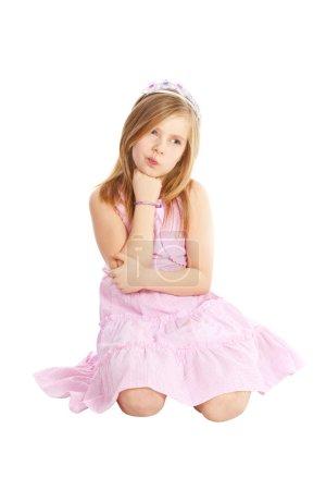 Photo pour Petite princesse en colère assise sur fond blanc - image libre de droit