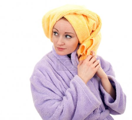 Woman in bathrobe and towel on head