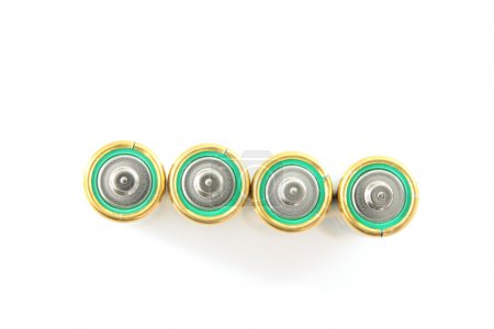 Four green batteries isolated on white background....